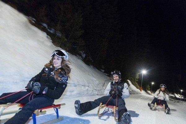 piste illuminate sciare e slittare in notturna a Obereggen Trentino alto Adige